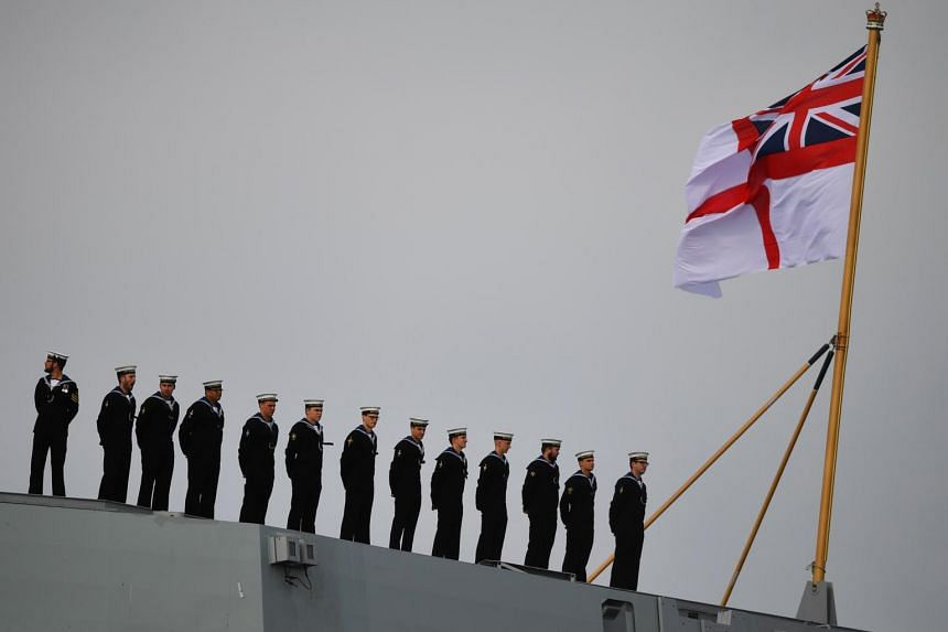Sailors on board the HMS Queen Elizabeth as they commemorate the 75th anniversary of D-Day, in Portsmouth, Britain, on June 5, 2019.