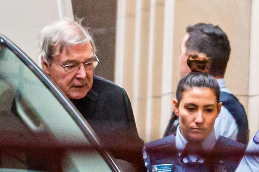Australian Cardinal George Pell (left) is escorted into the Supreme Court of Victoria in Melbourne on June 6, 2019.