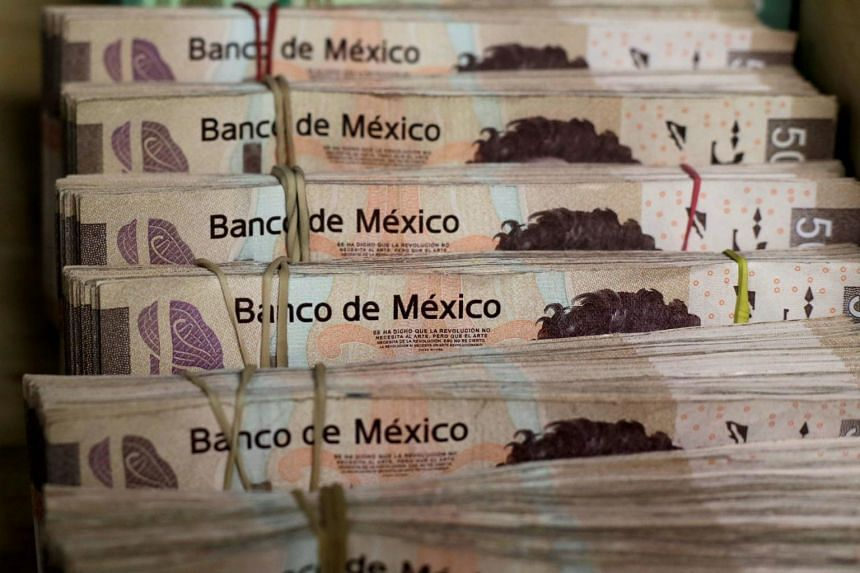 Bundles of Mexican Peso banknotes pictured at a currency exchange in Ciudad Juarez, Mexico, on Jan 15, 2018.