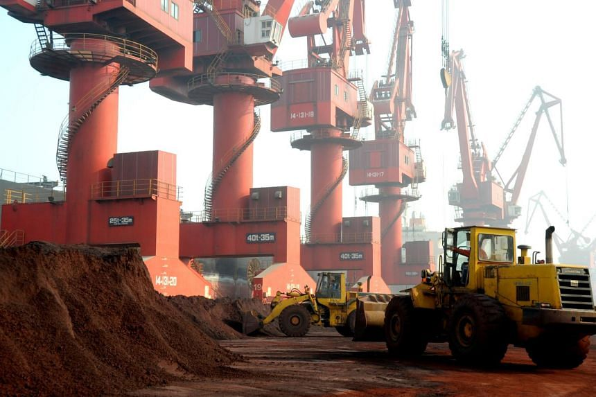 Workers transporting soil containing rare earth elements for export at a port in Lianyungang, Jiangsu province, China.
