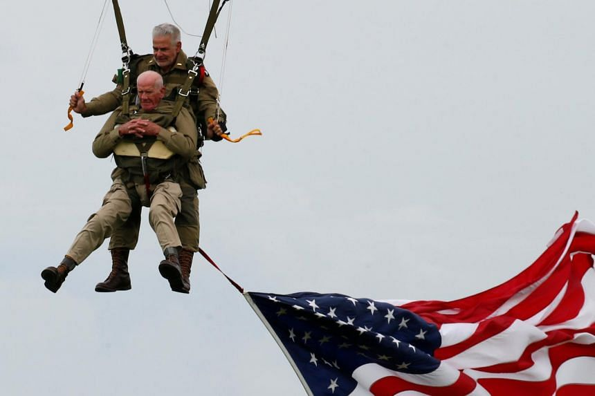US World War II paratrooper veteran Tom Rice participating in a commemorative parachute jump over Carentan on the Normandy coast in France, on June 5, 2019.