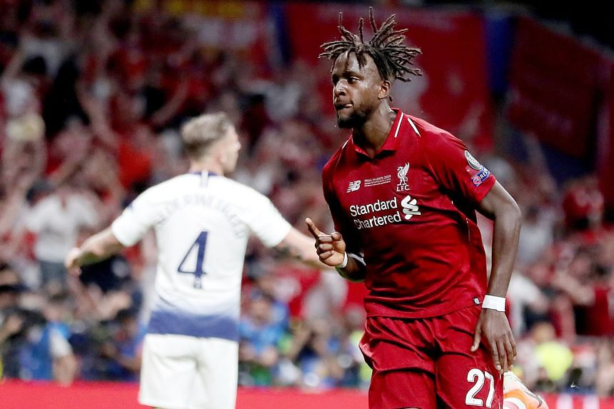 Liverpool striker Divock Origi celebrating after scoring the second goal in the 2-0 Champions League final win over Tottenham last Saturday. The Belgian has said that he is uncertain about his future at the Merseyside club despite making 21 appearanc
