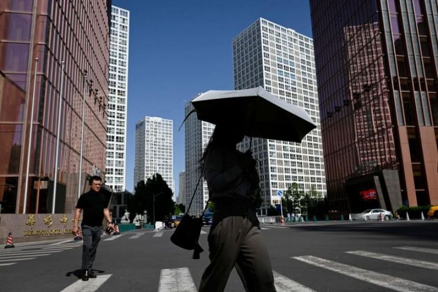 The downgrade came just two months after the International Monetary Fund raised its China growth forecast to 6.3 per cent from 6.2 per cent.