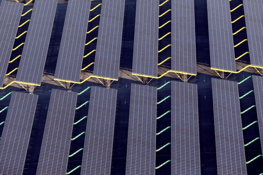 Solar panels used to produce renewable energy on the roof of a carpark in Bordeaux, south-western France, on Feb 29, 2016. A recent report said France is lagging in its bid to source 23 per cent of its energy from renewable sources by 2020.