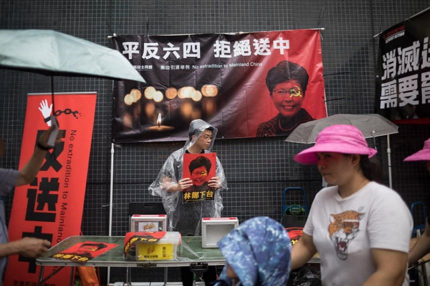 """Activists display posters opposing """"Extradition to mainland China"""" on June 4, 2019."""