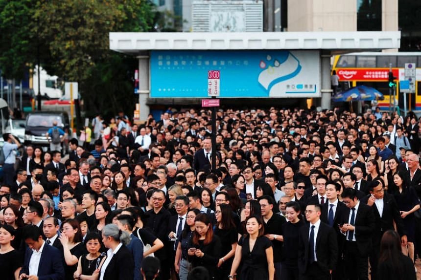 The lawyers walked in silence from the Court of Final Appeal to the government headquarters, where they gathered to observe three minutes of silence.
