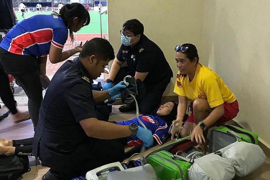 SCDF paramedics treating Miss Siti Nur Raihanah Waled after an ambulance was called.