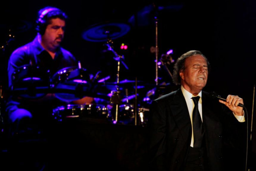 """Spanish singer Julio Iglesias (right) said it is """"a miracle"""" that his showbiz career has not run out of steam after 50 years."""