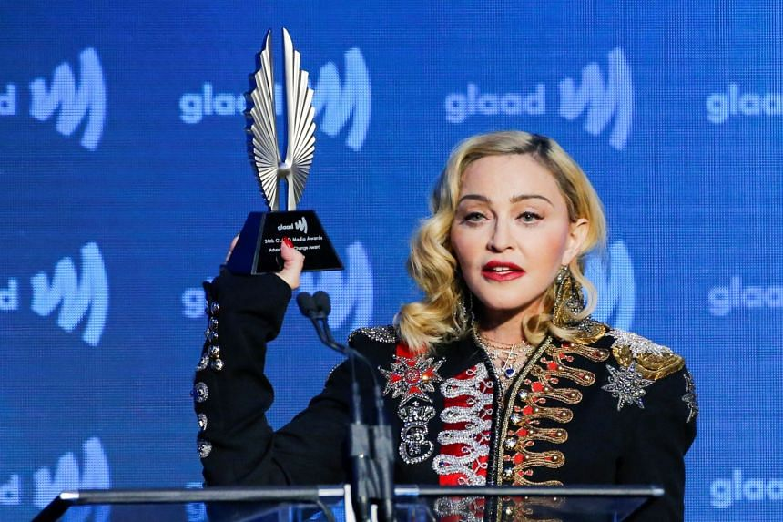 Madonna holds up her Advocate for Change award during the 30th GLAAD awards in May 2019.