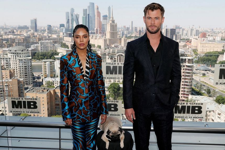 Chris Hemsworth and Tessa Thompson pose for a picture during a photocall in Moscow.