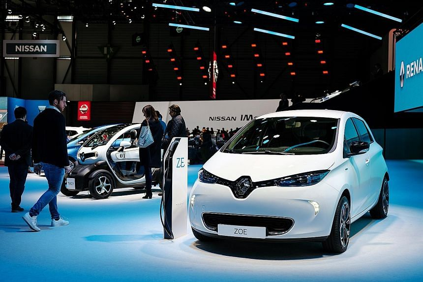 Renault's battery-powered subcompact Zoe on display at the Geneva International Motor Show last month. Fiat Chrysler and Renault told investors a merger would cut operating costs and investments by €5 billion or more a year. It is not clear what th