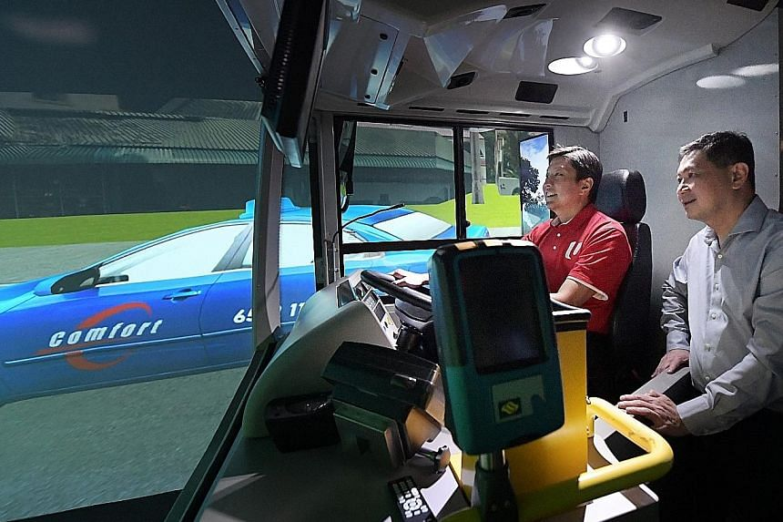 NTUC secretary-general Ng Chee Meng trying out a simulator at the Bus Training and Evaluation Centre during a visit to the Devan Nair Institute for Employment and Employability yesterday. Accompanying him was SMRT Roads president Tan Kian Heong. Truc