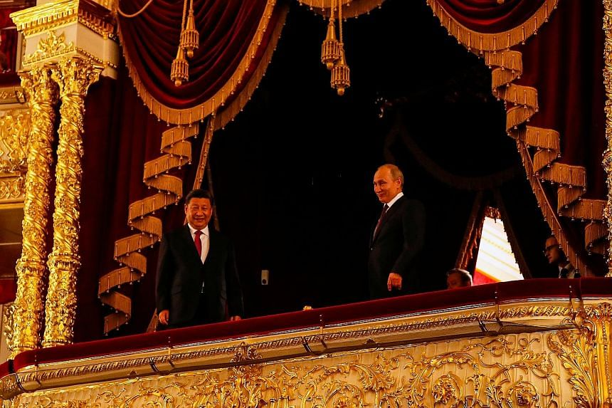 Russian President Vladimir Putin and his Chinese counterpart Xi Jinping at a ceremony on Wednesday at the Bolshoi Theatre in Moscow. The event was dedicated to the 70th anniversary of the establishment of diplomatic relations between the two countrie