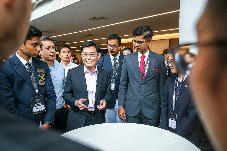 Deputy Prime Minister Heng Swee Keat speaking to students who attended the annual Pre-University Seminar yesterday. He urged them to venture into the fast-growing region, noting that many Asian companies are among the most innovative and best regarde
