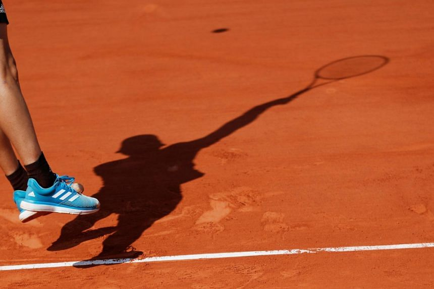 The silhouette of a tennis player during a game at the French Open in Paris, France, on June 6, 2019.