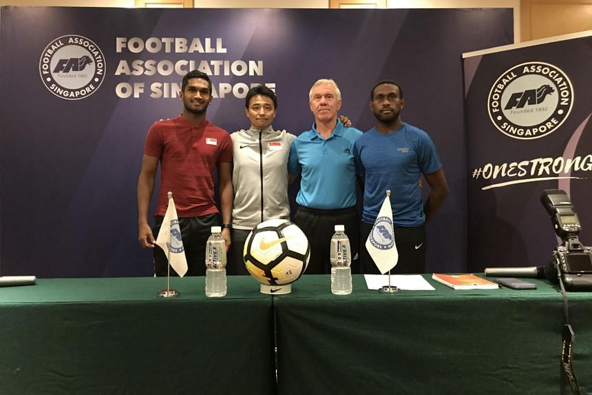 (From left) Singapore captain Hariss Harun, Singapore coach Tatsuma Yoshida, Solomon Islands coach Wim Rijsbergen and his captain Benjamin Totori posing at the pre-match press conference on Friday (June 7).