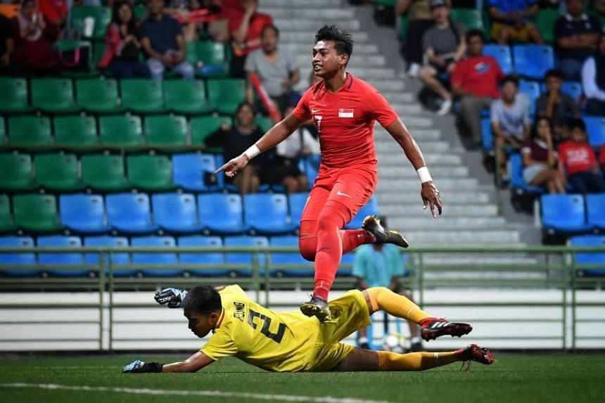 Amiruldin Asraf beats Philippines' goalkeeper Michael Asong to score for Singapore in the Merlion Cup 2019 match at the Jalan Besar Stadium on June 7, 2019.