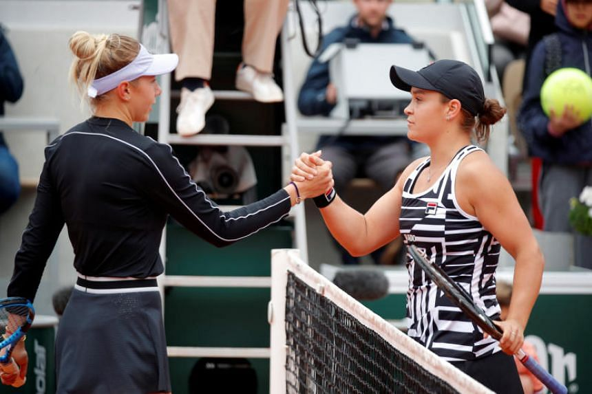 Ashleigh Barty (right) shakes hands with Amanda Anisimova after their semi-final match at the French Open on June 7, 2019.