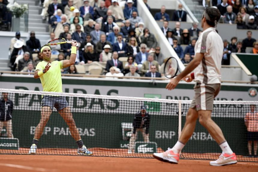 Rafael Nadal (left) plays Roger Federer during the men's semi final match during the French Open tennis tournament at Roland Garros in Paris, on June 7, 2019.