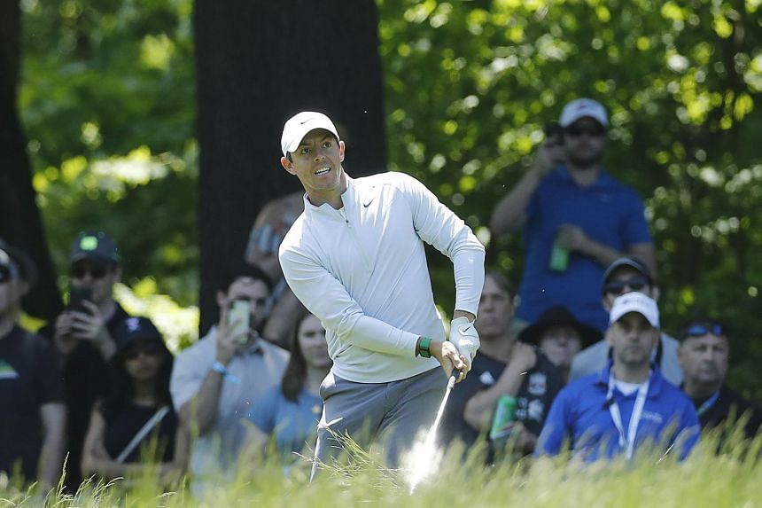 Rory McIlroy playing a shot on the seventh hole during the first round.