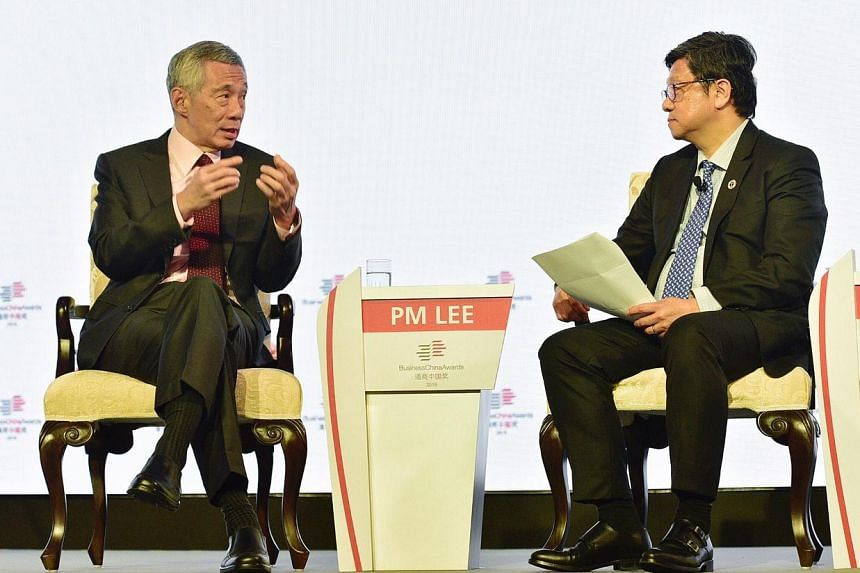 Prime Minister Lee Hsien Loong speaks with Business China director Robin Hu at a fireside chat at the Sands Expo and Convention Centre on June 7, 2019.