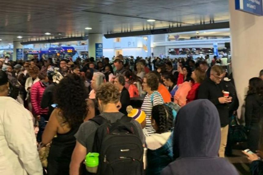 Hundreds of passengers stood in a lengthy line that snaked outside the terminal as they waited to be checked by security.