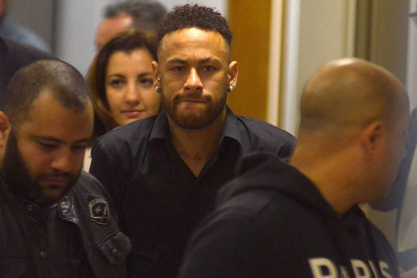 Brazilian soccer player Neymar leaves the police station after testifying in Rio de Janeiro, Brazil on June 6, 2019.