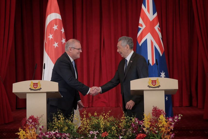 Australia's Prime Minister Scott Morrison and Prime Minister Lee Hsien Loong attend a joint press conference at the Istana on June 7, 2019.