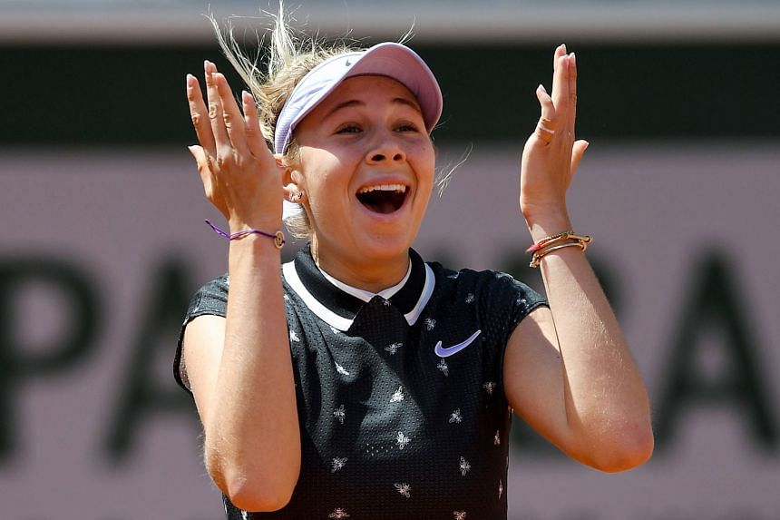American Amanda Anisimova, 17, celebrating after ousting defending champion Simona Halep of Romania from the French Open yesterday. Anisimova won their quarter-final clash 6-2, 6-4. PHOTO: AGENCE FRANCE-PRESSE