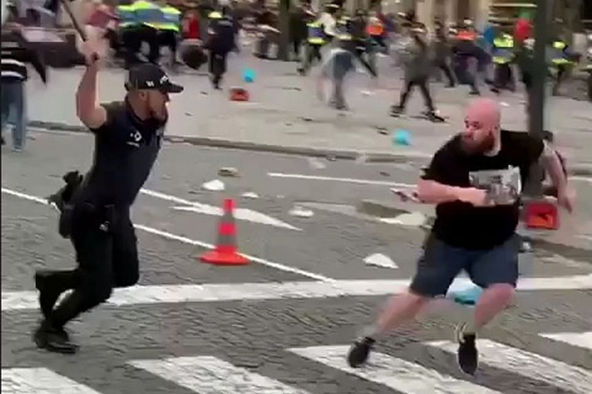 A video grab of police clashing with England fans at a Nations League fan zone in Porto on Wednesday. Three fans were reportedly arrested.