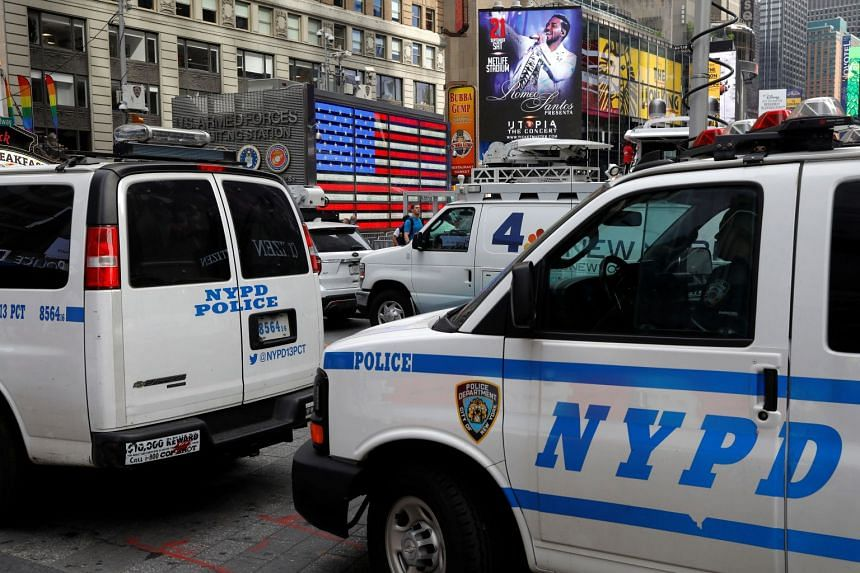 Police vehicles patrol in Time Square after a man was arrested in an alleged plot to buy grenades and detonate them there.