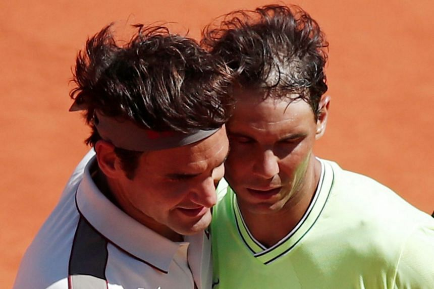 Switzerland's Roger Federer and Spain's Rafael Nadal after their semi-final match.
