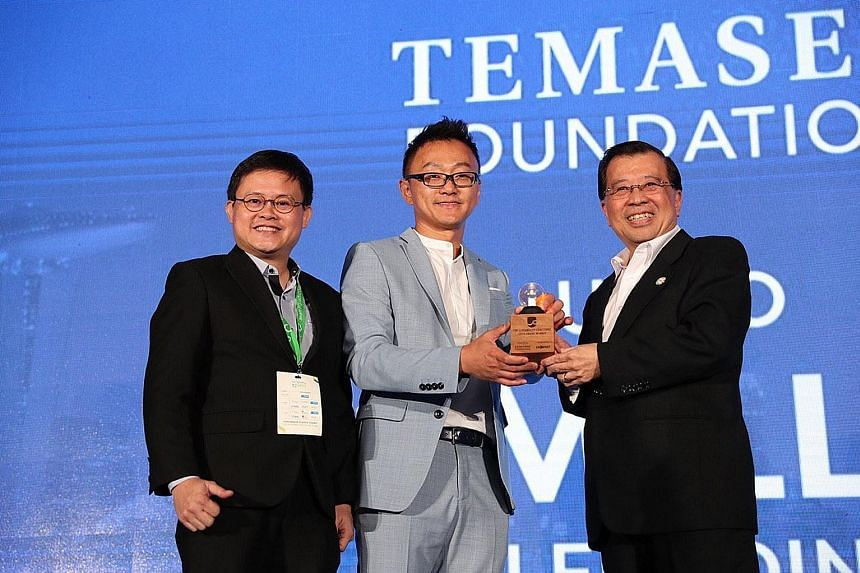 (From far left) Sophie's Kitchen co-founder and chief operating officer Barnabas Chan and founder and chief executive Eugene Wang receiving the award from Temasek Foundation Ecosperity CEO Lim Hock Chan at the Sands Expo and Convention Centre at Mari