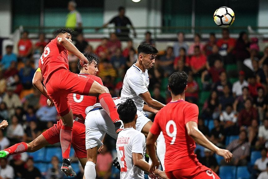 Irfan Fandi (far left) putting Singapore 2-0 up in the Merlion Cup game against the Philippines at Jalan Besar Stadium yesterday.