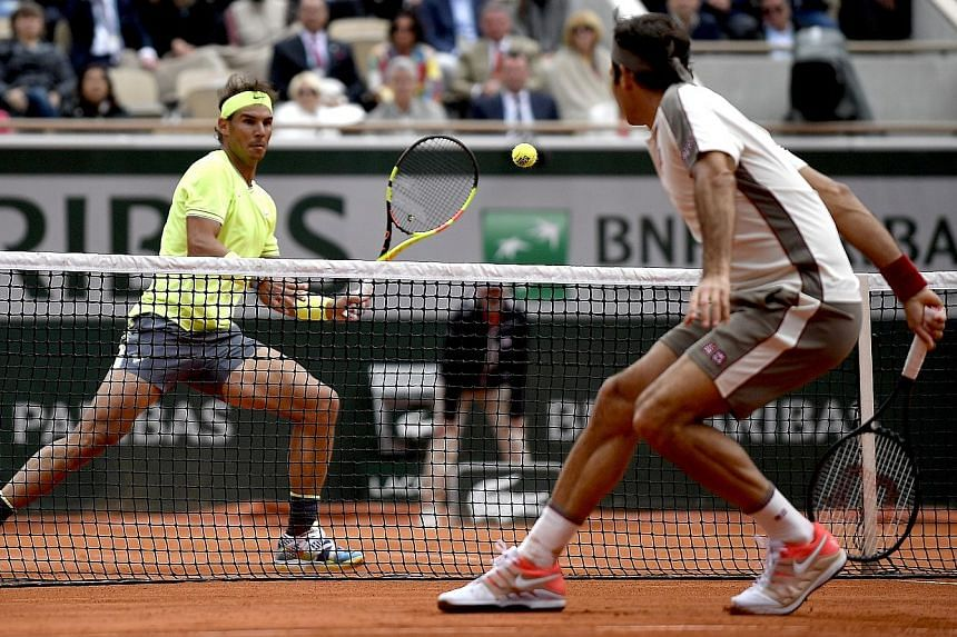 Rafael Nadal preparing for a forehand against Roger Federer in their French Open semi-final in Paris yesterday. His record at Roland Garros is now a staggering 92-2 and he is gunning for a 12th title.