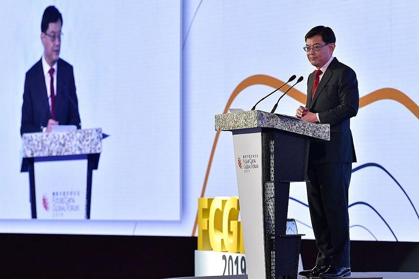Mr Heng Swee Keat speaking at the FutureChina Global Forum yesterday. He said the world's progress over the past decades could unravel if the key challenges are not managed well. ST PHOTO: NG SOR LUAN