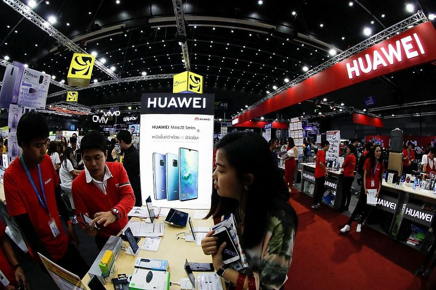 Visitors at the Huawei booth at the Mobile Expo in Bangkok last month. The switch to Huawei's new OS is unlikely to scare away Chinese phone buyers, but whether overseas consumers who depend on Google's offerings will take to it remains to be seen. P