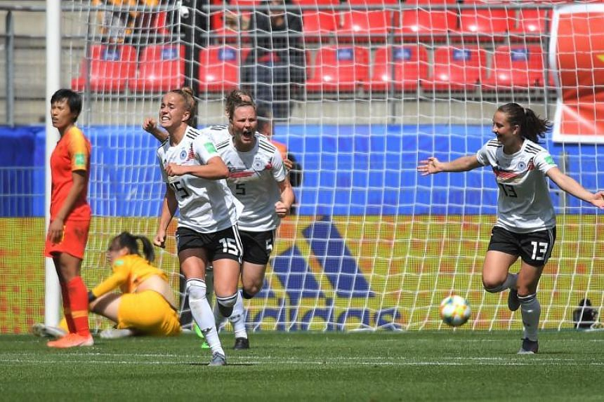 Germany's Giulia Gwinn (left) celebrates after scoring during the France 2019 Women's World Cup Group B football match against China at the Roazhon Park stadium in Rennes, France, on June 8, 2019.