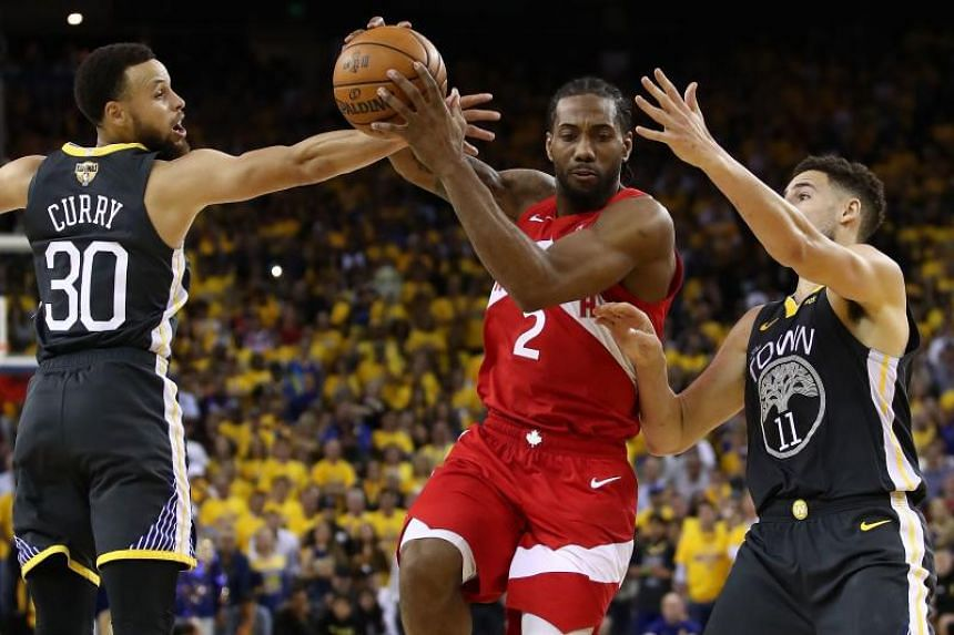 Kawhi Leonard (centre) scored 36 points and grabbed 12 rebounds to power the Toronto Raptors over the Golden State Warriors 105-92 for a 3-1 lead in the best-of-seven series.