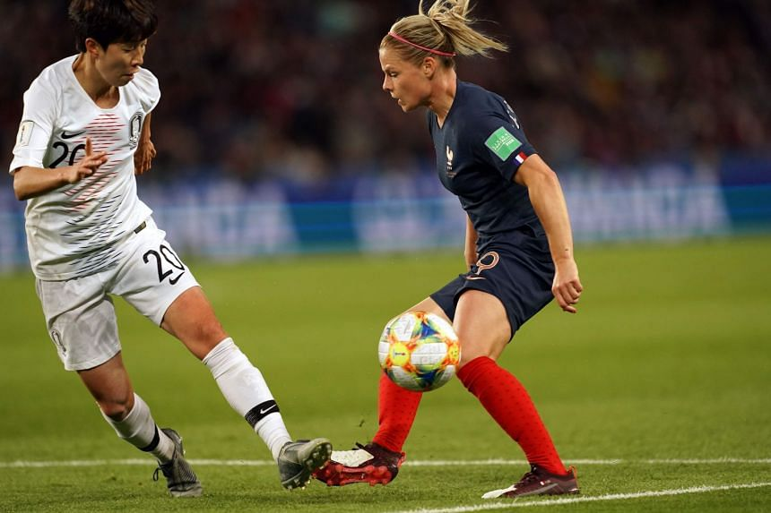 South Korea's defender Hye-Ri Kim (left) vies with France's forward Eugenie Le Sommer (right).