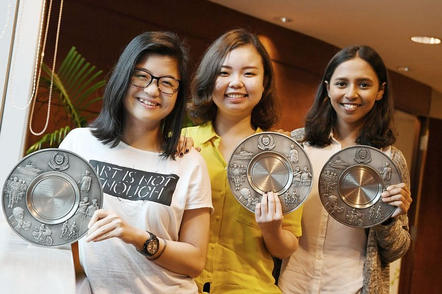 Part-time food delivery rider Muhammad Talip Ajman Ali chased after a man suspected of stealing a mobile phone near Lower Delta Road and helped in his arrest. The Fullerton Bay Hotel's Ms Maria Leong (far left) with rooms division manager Rhea Maria