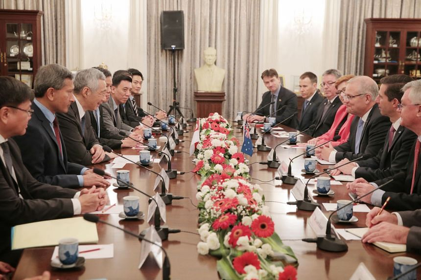 Prime Minister Lee Hsien Loong, flanked by Foreign Minister Vivian Balakrishnan and Trade and Industry Minister Chan Chun Sing, meeting Australian Prime Minister Scott Morrison (third from right), flanked by Trade, Tourism and Investment Minister Sim