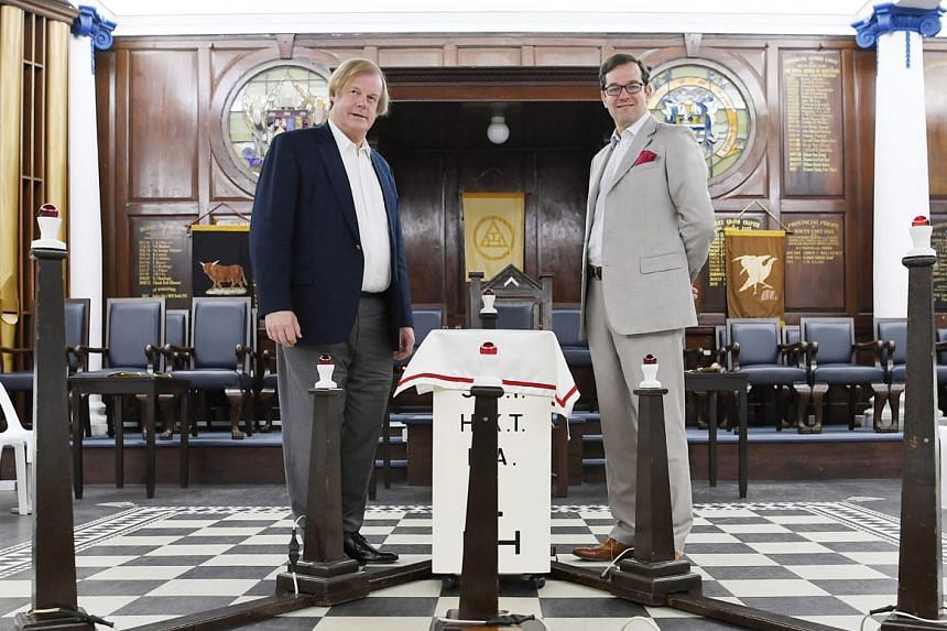 Sir David Wootton (far left), assistant grand master of the United Grand Lodge of England, with its grand secretary, Dr David Staples, in the main temple of the Freemasons' Hall in Singapore yesterday. They are in Singapore for the assembly of the Di