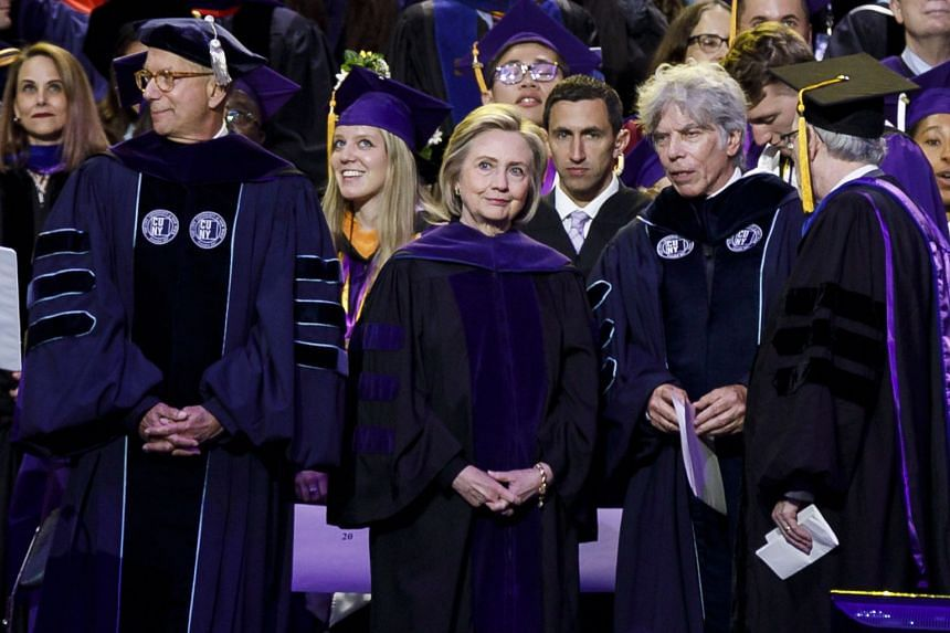 Clinton (centre) attending Hunter College's commencement ceremonies at Madison Square Garden in New York, May 29, 2019.