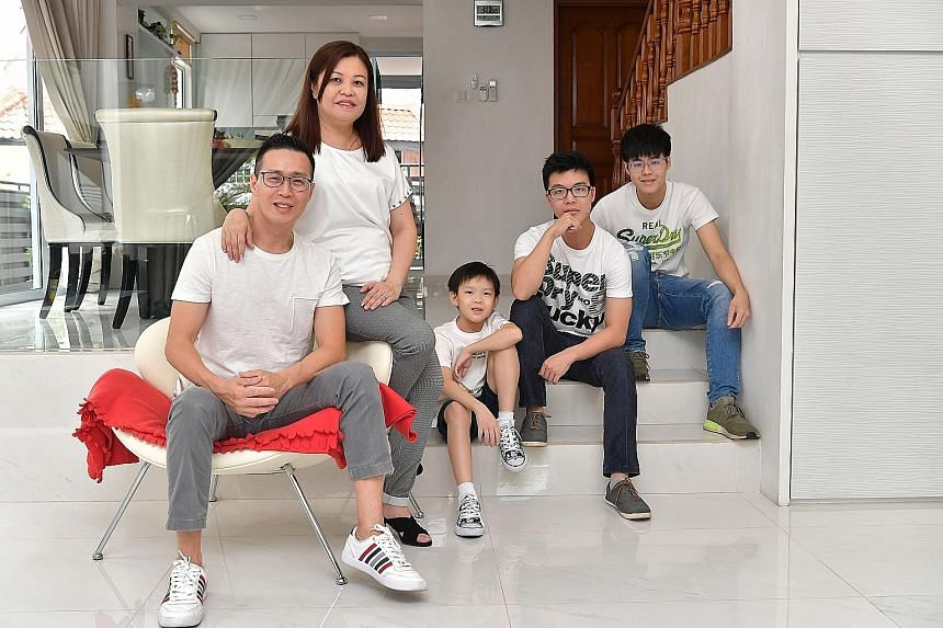 Mr Lim says his dream home is a freehold semi-detached house that is near nature and by the sea, with a big yard for gardening and a spacious corner. Mr Adrian Lim at home with his wife Jasmine and their three sons (from left) Ze Kai, eight, Yan Kai,