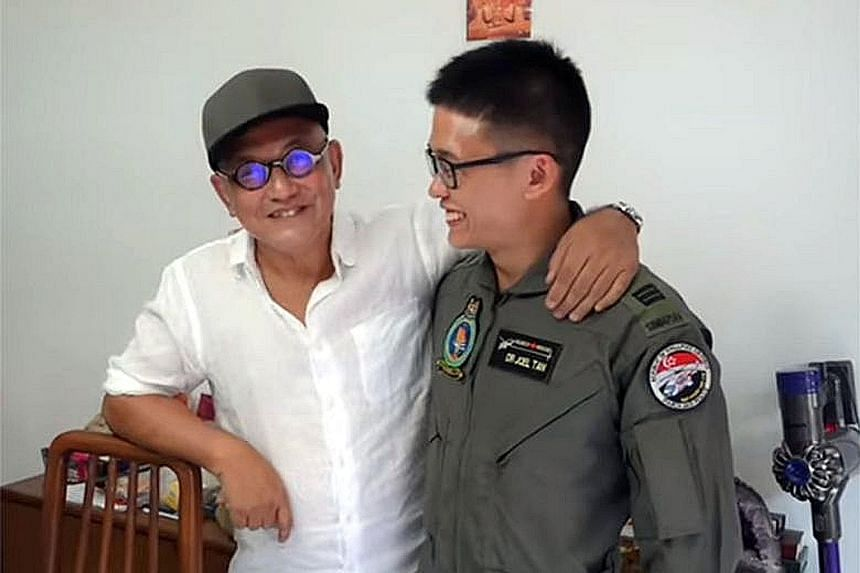 Mr John Low meeting one of the rescuers, Captain (Dr) Joel Tan, on Friday - a month after he was lifted into a helicopter from a ship that had picked him up from the South China Sea.