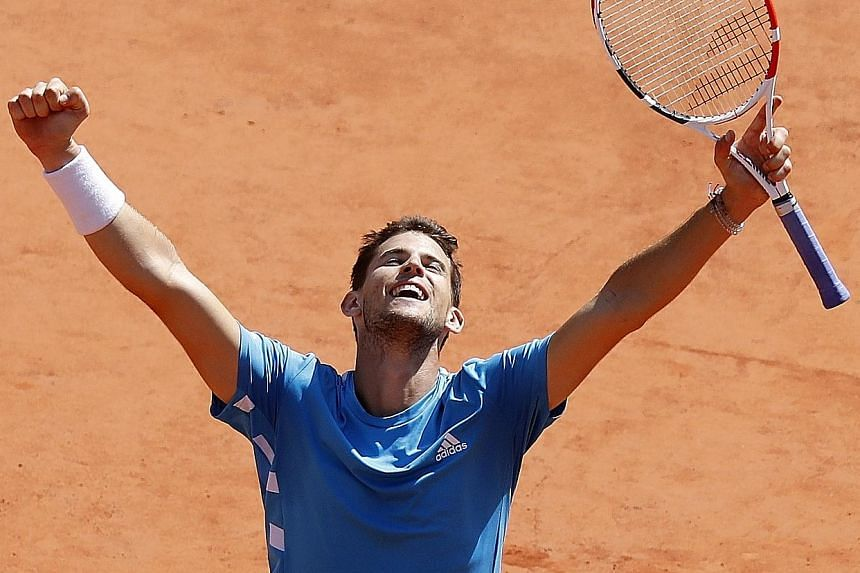 A triumphant Dominic Thiem of Austria after his 6-2, 3-6, 7-5, 5-7, 7-5 semi-final victory over Serbia's Novak Djokovic yesterday. PHOTO: REUTERS