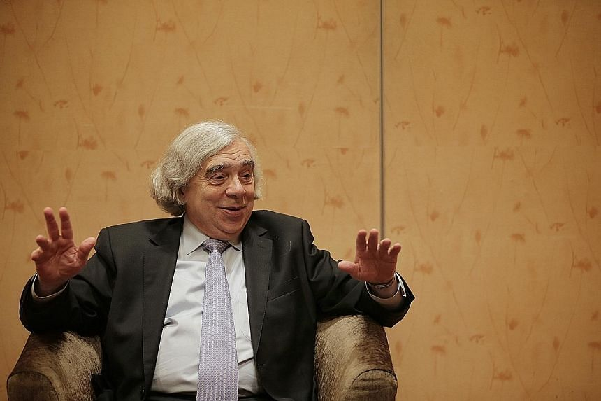 Leading energy specialist Ernest Moniz, who was speaking to The Sunday Times on Thursday on the sidelines of the Ecosperity Conference, called for closer cooperation among Asean nations to reach low-carbon goals. ST PHOTO: JASON QUAH