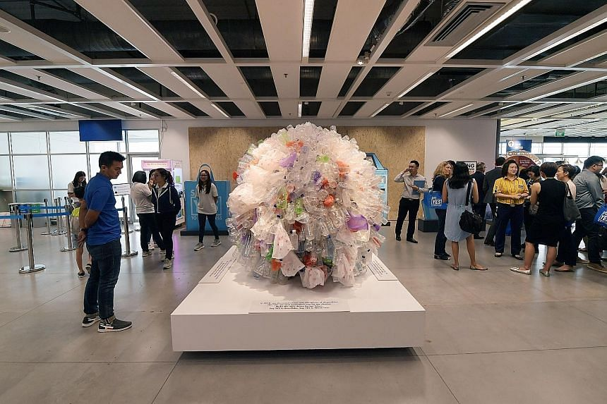A sculpture made of plastic bottles and plastic bags at Ikea Tampines yesterday. Last year, about 164,500 tonnes of domestic waste here was made up of disposables - enough to fill about 300 Olympic-size swimming pools.
