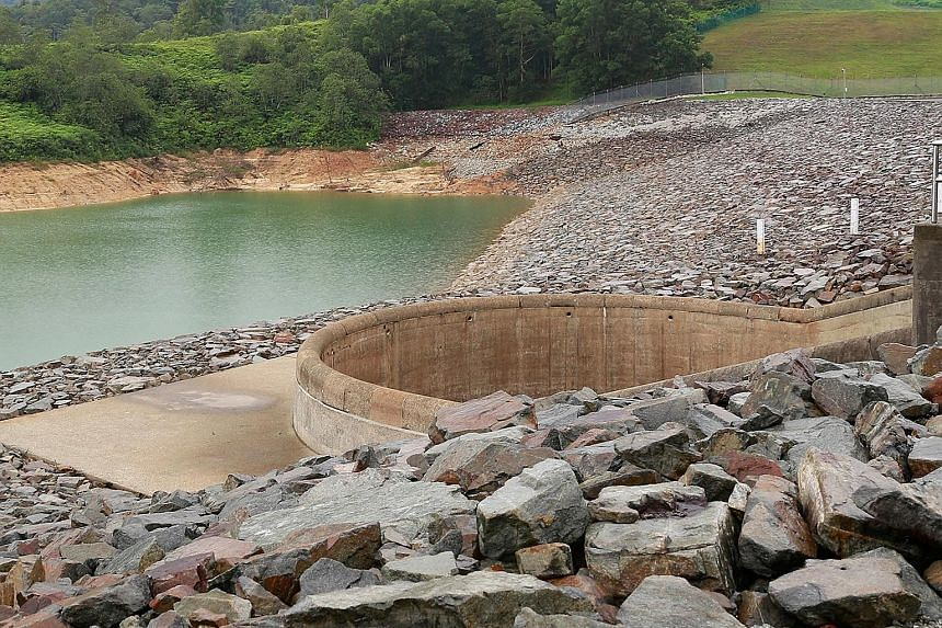 The water level in Johor's Linggiu Reservoir, from where Singapore largely gets its raw water from Malaysia, was at 55 per cent in August 2015. During dry months, PUB ramps up production of Newater and desalinated water. PHOTO: PUB A cyclist wearing